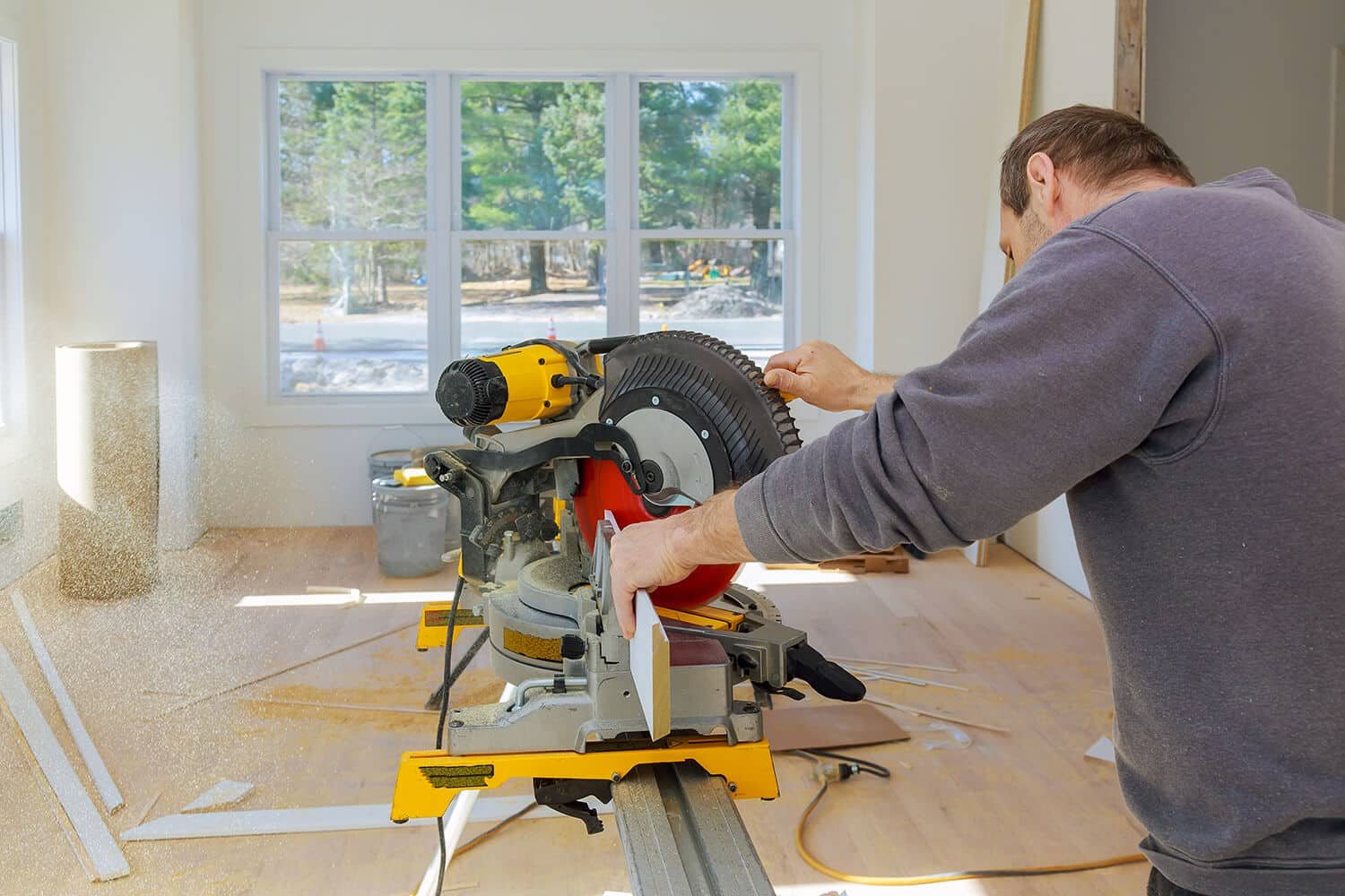 The Inside Corner Cuts Baseboards With a Miter Saw