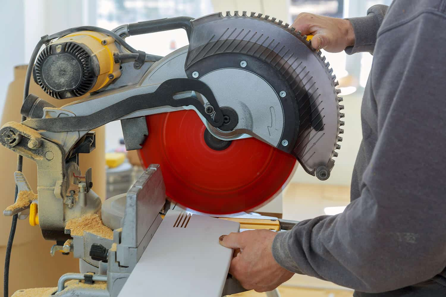 The Square Cuts Baseboards With a Miter Saw